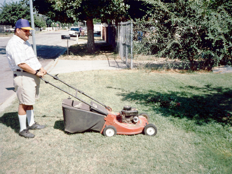 Jose mowing a lawn in 1996